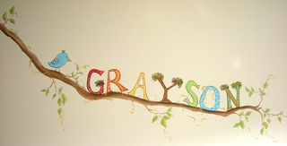 Chicago nursery muralist paints baby's name in Jungle themed nursery