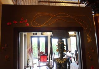 Indian-gardens-restaurant-mural-rose-petals-prayer-beads